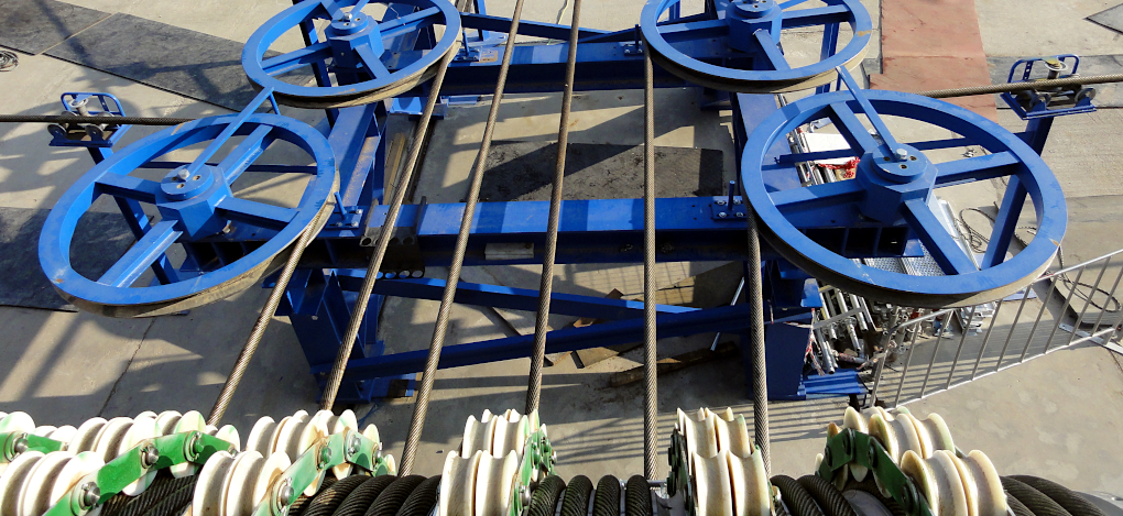 View from the mobile friction winch onto the horizontal deflector sheaves with incoming ropes.